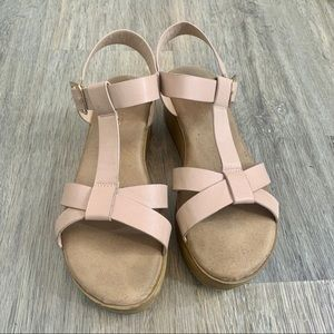 Tan and cream colored Sandals with elevation